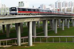 Singapore mass rapid train (MRT) travels on the track in Jurong East, Singapo - stock photo