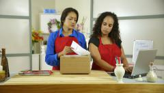 Two hispanic small business owners working at the counter Arkistovideo