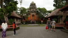 Walk through outer courtyard to the towered gate, Ubud Palace - stock footage