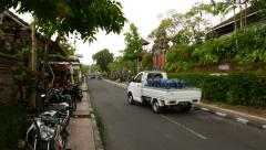 Empty balinese street, motorbike and few car passing by Stock Footage
