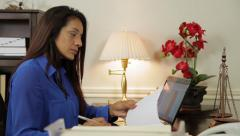 hispanic woman ceo working in her office smiles at someone - stock footage
