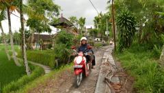 Narrow way under construction at rural area, motorbike drive towards Stock Footage
