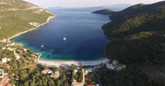 Stock Video Footage of Aerial view of people enjoying on the Greek Lefkada sandy beach
