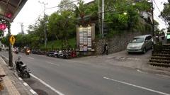 T-junction traffic in dusk, narrow Balinese streets motorbike drive Stock Footage