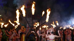 Burning torches on sticks, dance performance on background, night time Stock Footage
