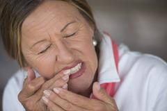 Woman toothache in pain portrait Stock Photos