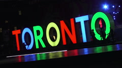 Big Toronto Sign at  Nathan Phillips Square in the evening Stock Footage