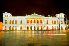 Sucre Theather, Quito, with banner of Ecuador - stock photo