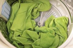 towels in washing machine - stock photo