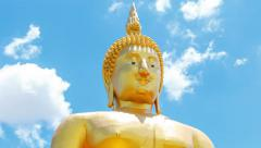 Buddha statue on cloud and blue sky at temple of Thailand Stock Footage