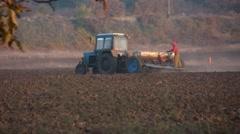 Tractor working in a Ukrainian field Stock Footage
