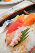 Delicious mixed sashimi on a plate. Stock Photos