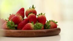 Strawberry, red strawberries in a wooden plate. Dolly shot Stock Footage