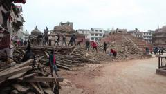 People from Kathmandu cleaning up the rubbles in Durbar Square after a huge 7.8M Stock Footage