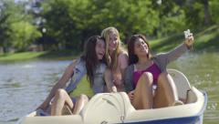Girls Pose For Selfie On A Boat, Girl Pretends To Drop Her Phone Overboard Stock Footage