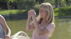 Girls Ride A Pedal Boat, Blonde Takes A Photo Of Friends, Shares The Picture Stock Footage
