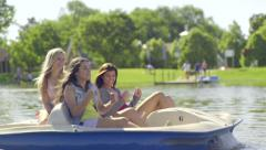 Teen Girls Pedal Hard In Pedal Boat, Pretend Like They Are Running, Funny Joke Stock Footage