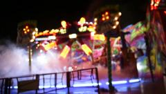 Carousel at night defocused view Stock Footage