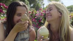 Closeup Of Best Friends Eating Ice Cream Cones, They Smile And Hug Stock Footage