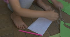 Little Girl With Blond Hair, in Pink T-Shirt And Gray Trousers, Is Sitting on a Stock Footage