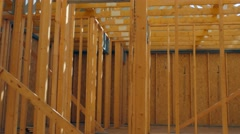 Construction site with wooden framed roof Stock Footage