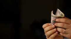 Showing the money on black background with copy space Stock Footage