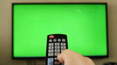 POV holding remote control with green screen inside tv LED screen Stock Footage