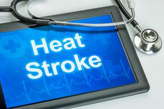 Tablet with the word Heat Stroke on the display - stock illustration