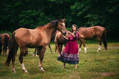 Stock Photo of Beautiful gypsy in violet dress