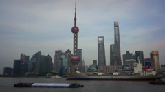 Freight ships sailing on Huangpu river, passing by Oriental Pearl tower Stock Footage