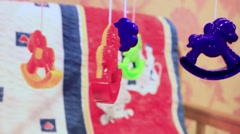 Baby cot with hanging  toys Stock Footage
