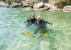 Happy Scuba Divers - stock photo