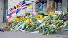 MH17 Flowers and toys memorable memorial near Dutch Embassy (Kiev). - stock footage