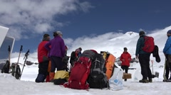 Stock Video Footage of Successful ascent of athletes going home. Elbrus. Eco travel.