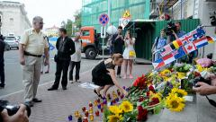 MH17 Flowers and toys memorable memorial near Embassy of the Netherlands (Kiew). - stock footage