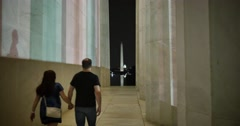 Couple Walks Outside Lincoln Memorial at Night - stock footage