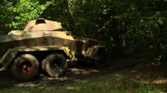 WWII German Armored Vehicle Enters Forest Stock Footage