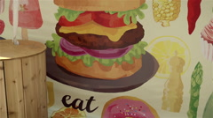 Cheeseburger painted on the wall. Stock Footage