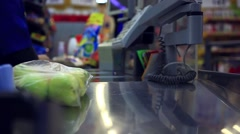 Hands cashier check out goods line at the supermarket checkout Stock Footage