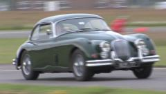 Jaguar xk120 on track - stock footage