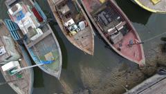 Aged rowboat on the water from an old fishing village in Brazil from above view - stock footage