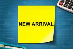 New arrival word on yellow note Stock Photos
