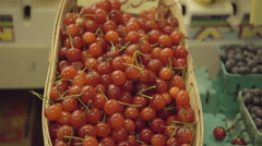 Fresh sour cherries at the farmers market. Stock Footage