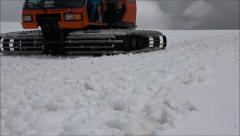 Tractor rides to rescue climbers got snow blockage. Elbrus. Slow motion. - stock footage