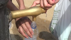 collects the water from the old fashioned water pump - barcelona city - stock footage