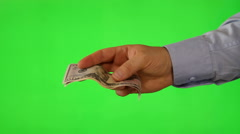Hand offering money on green screen Stock Footage