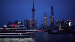 Cruise ship sailing on Huangpu river at night, passing by Oriental Pearl tower Stock Footage