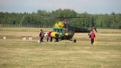 People prepare the plane for take-off, a rescue operation, helicopter games Stock Footage