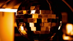 Sparkling gold disco ball on a glowing background Stock Footage