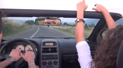 Beautiful brunette have fun riding in a convertible cabriolet car Stock Footage